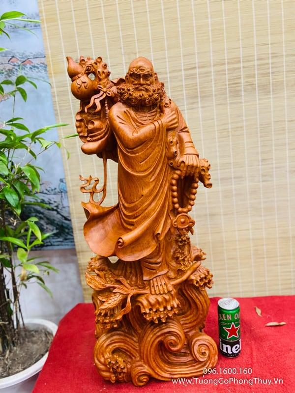 Tượng đạt ma quá hải đứng cành sen cao 80cm gỗ hương